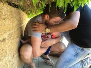 Stranger shields father and newborn with his own body - during Operation Protective Edge.