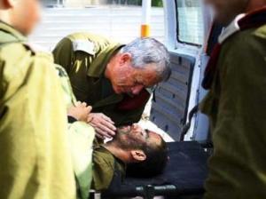 IDF Chief of Staff Benny Gantz evacuating a wounded soldier