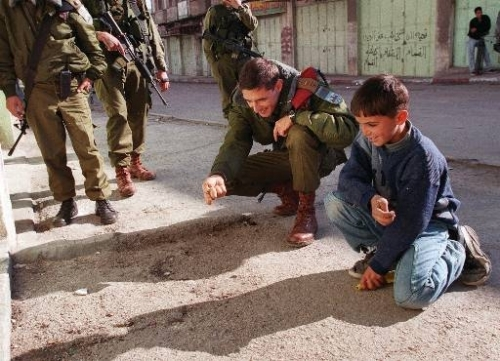 IDF Paratrooper plays with a Palestinian child in Gaza