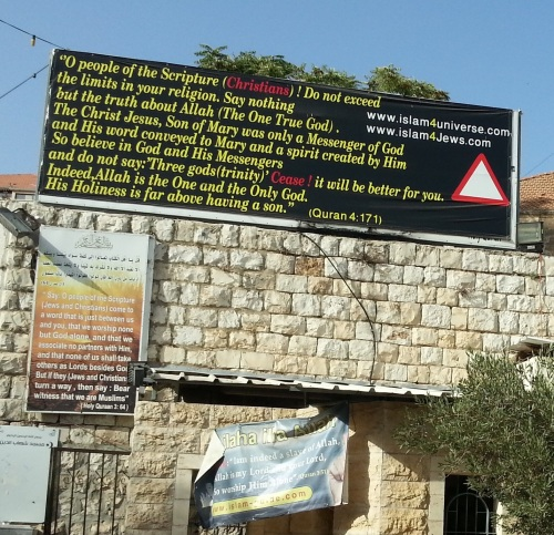 signs in front of the Basilica of the Annunciation