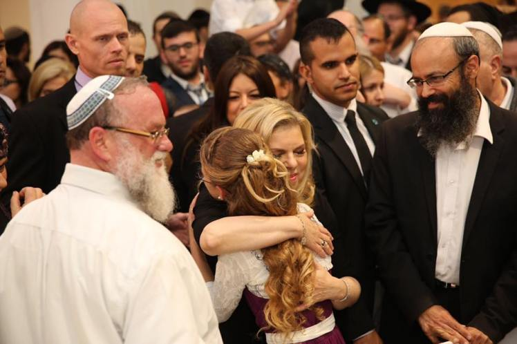 "I'm hugging you in my name, in the name of the prime minister and in the name of all of Israel,"" she said while embracing the bride. ""I hope you will build a faithful home in Israel."