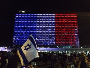 Tel Aviv city hall lit up like the French flag